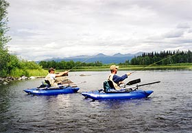 Two men fly fishing from float tubes.